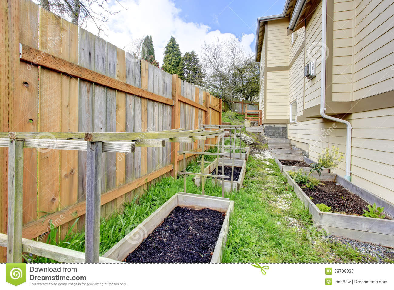 Small Backyard Garden Bed Wih Wooden Trellis Royalty Free