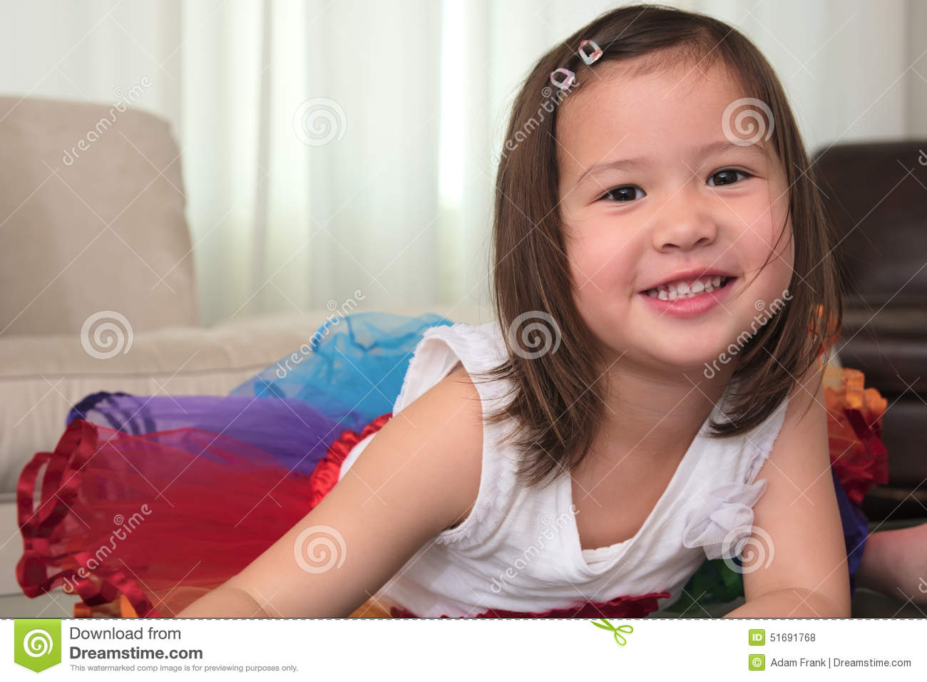 Smiling Biracial Female Asian Child Lying On Stomach Smiling Stock Photo Image 51691768