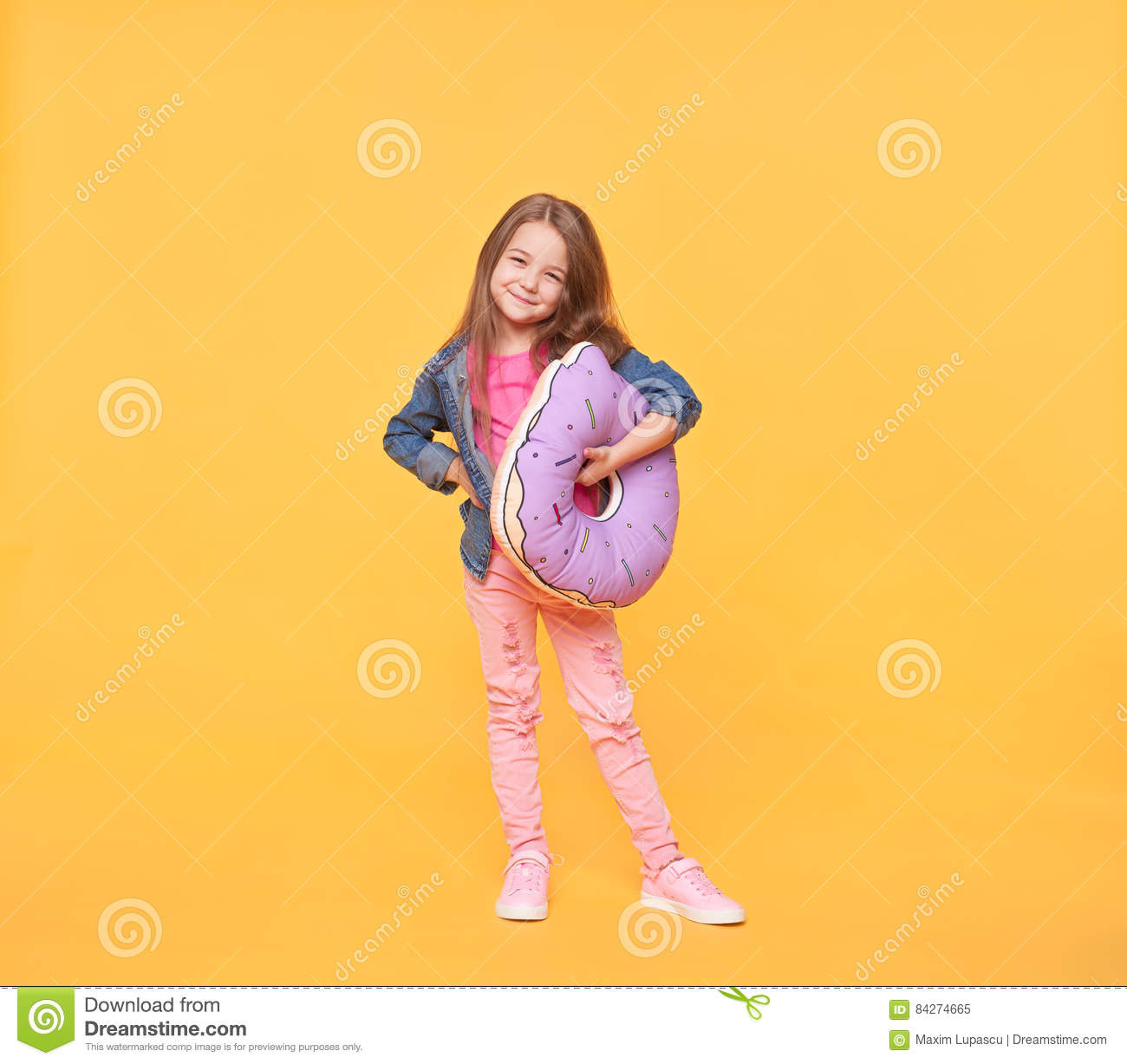 smiling little girl holding a giant donut pillow stock image image of bright funny 84274665