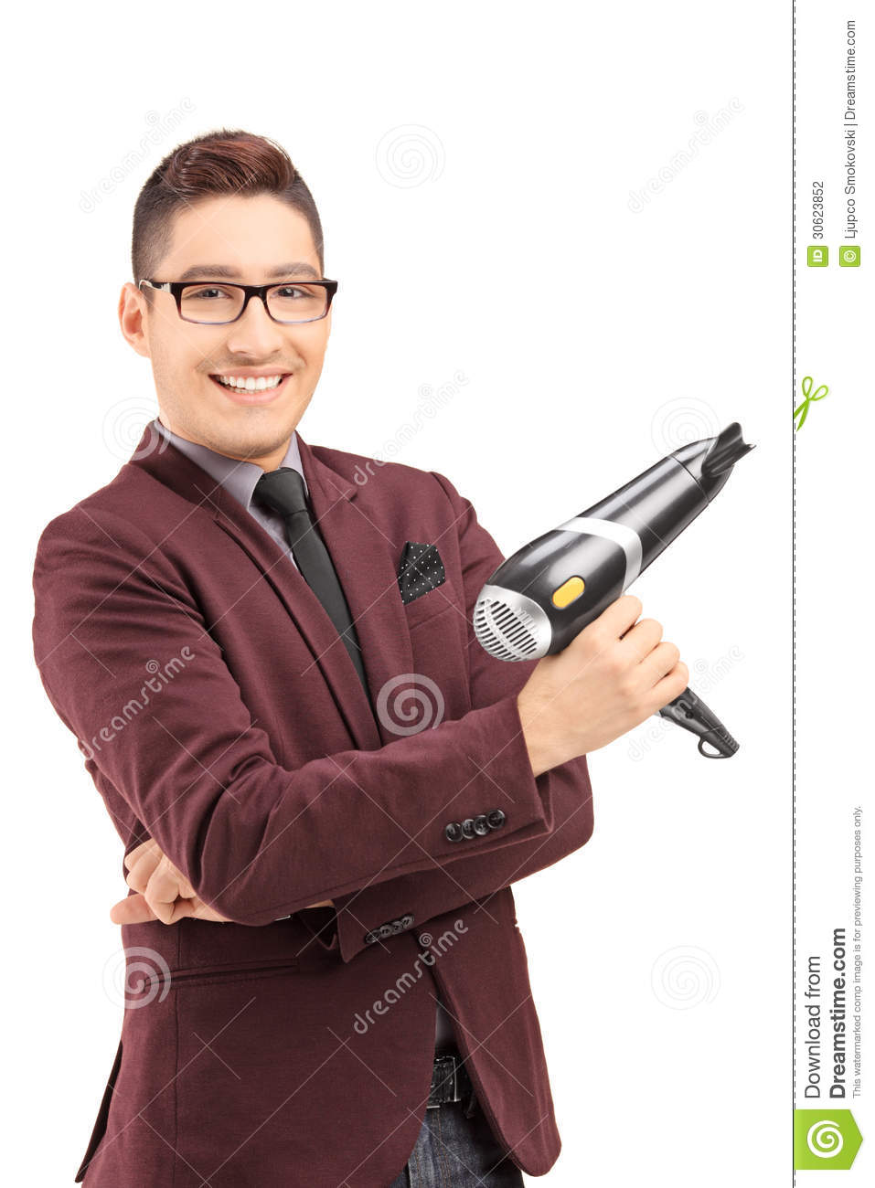 Smiling Male Hairdresser Holding A Blow Dryer Stock