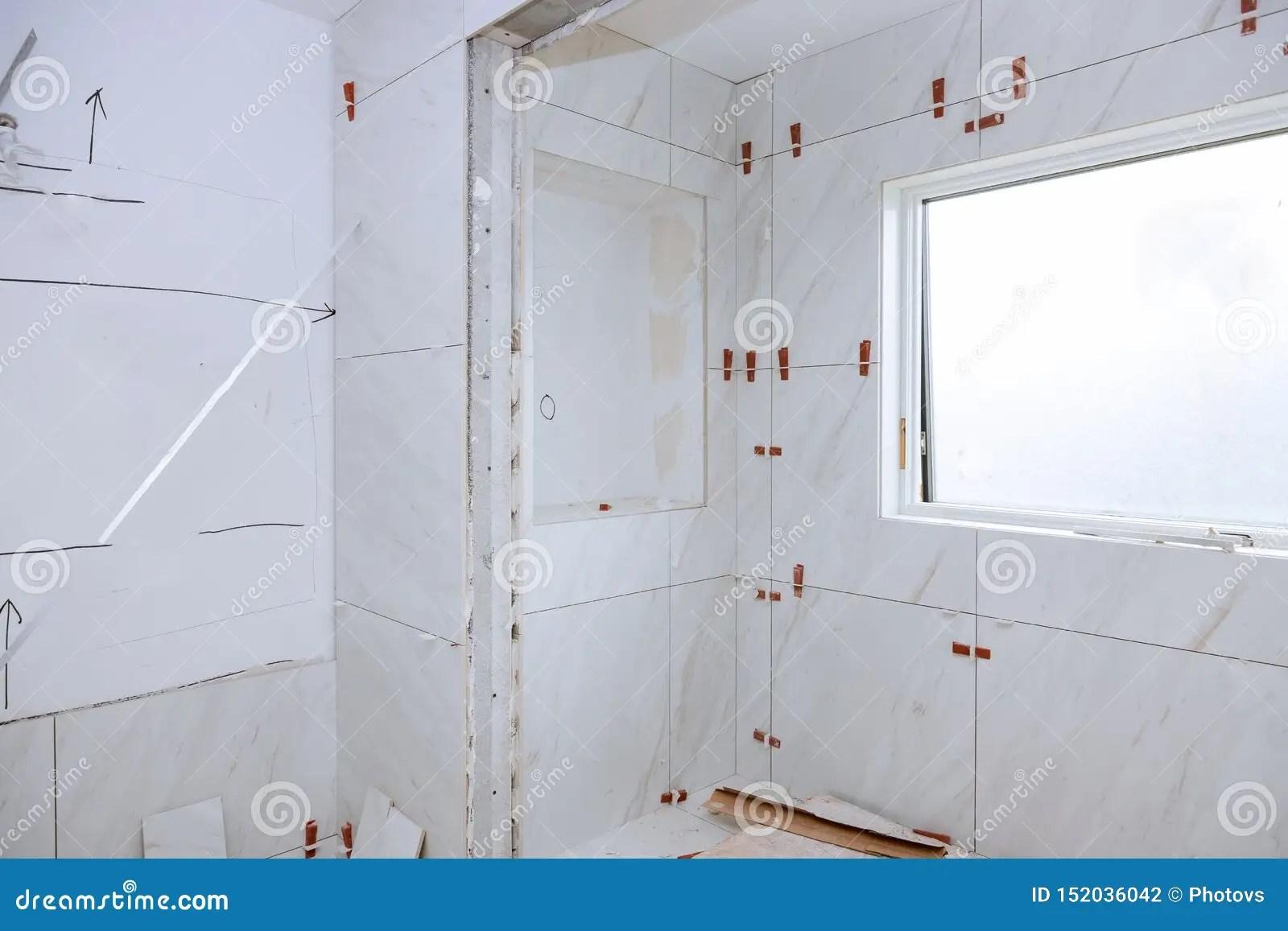 https www dreamstime com spreading wet mortar applying tiles bathroom tile work laying image152036042