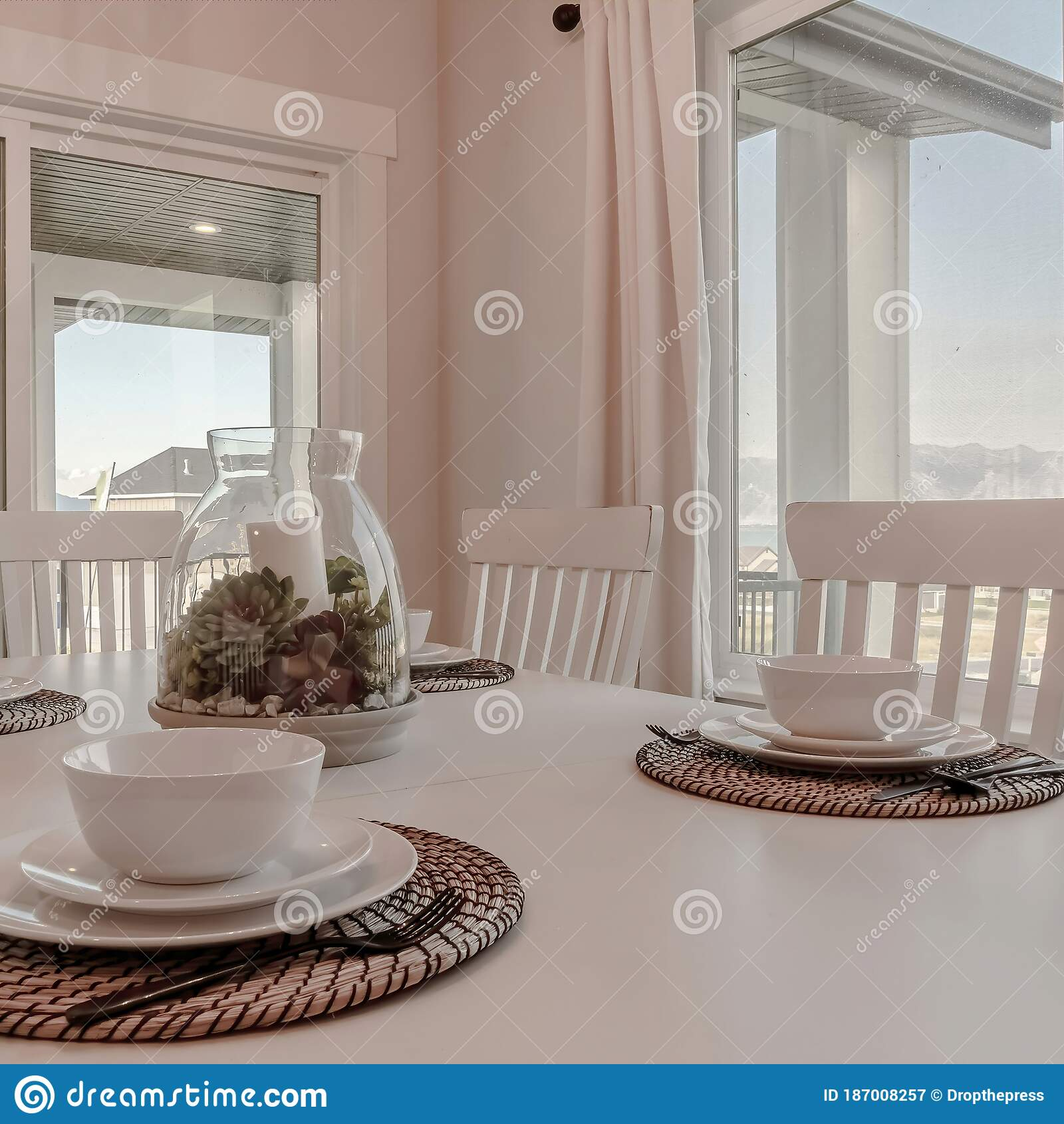 square dining table with tableware and woven placemat arranged around a centerpiece stock image image of mountain ornamental 187008257