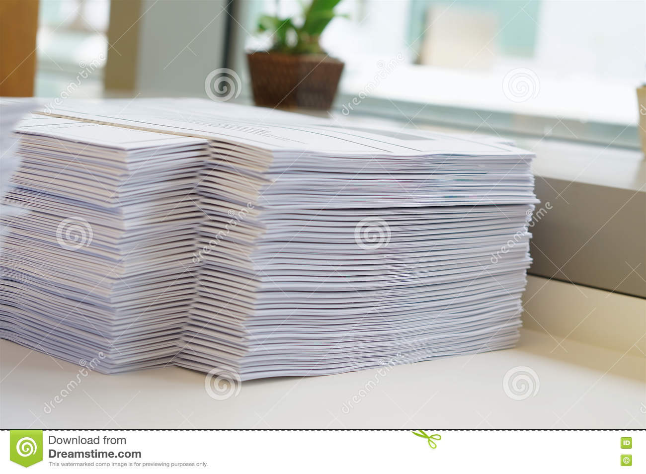 Stack Of Papers Worksheet Near Window Stock Photo