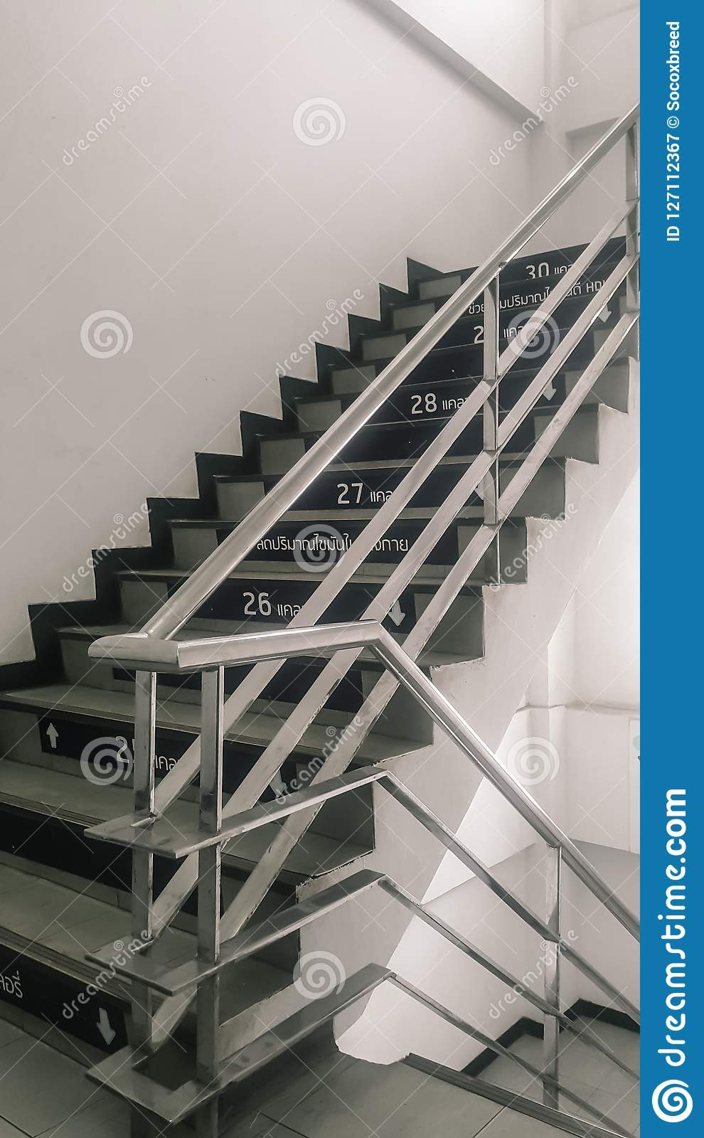 Stairs Up In The Building With Stainless Steel Handrails Stock   Stainless Handrails For Stairs   Toughened Glass   Outdoor   Mild Steel Handrail   Commercial Building   Metal