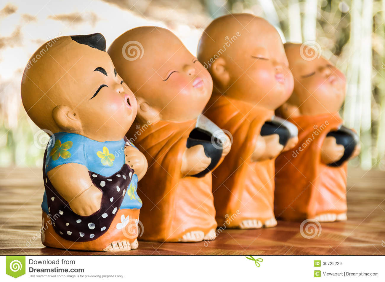 Statues Of Baby Buddhist Monks Royalty Free Stock Images