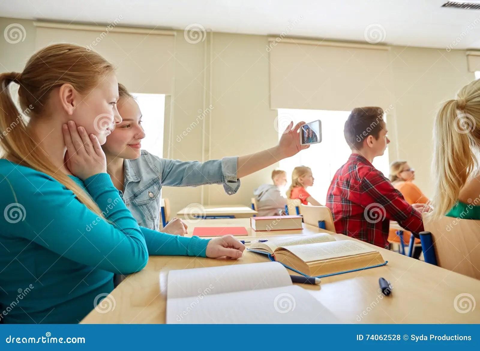 Student Girls Taking Smartphone Selfie At School Stock Photo