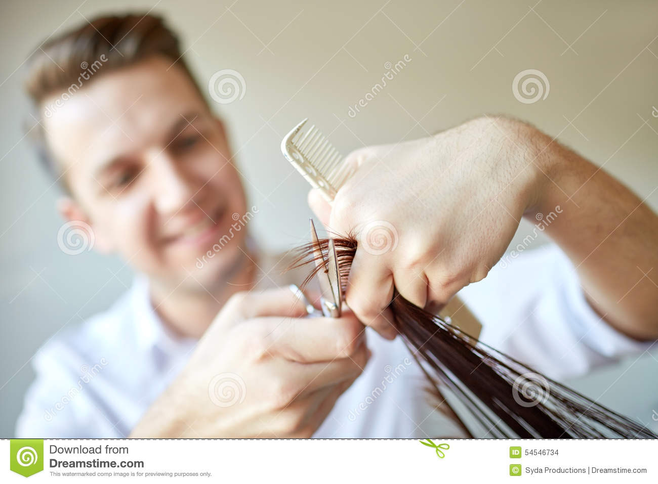 Stylist With Scissors Cutting Hair Tips At Salon Stock