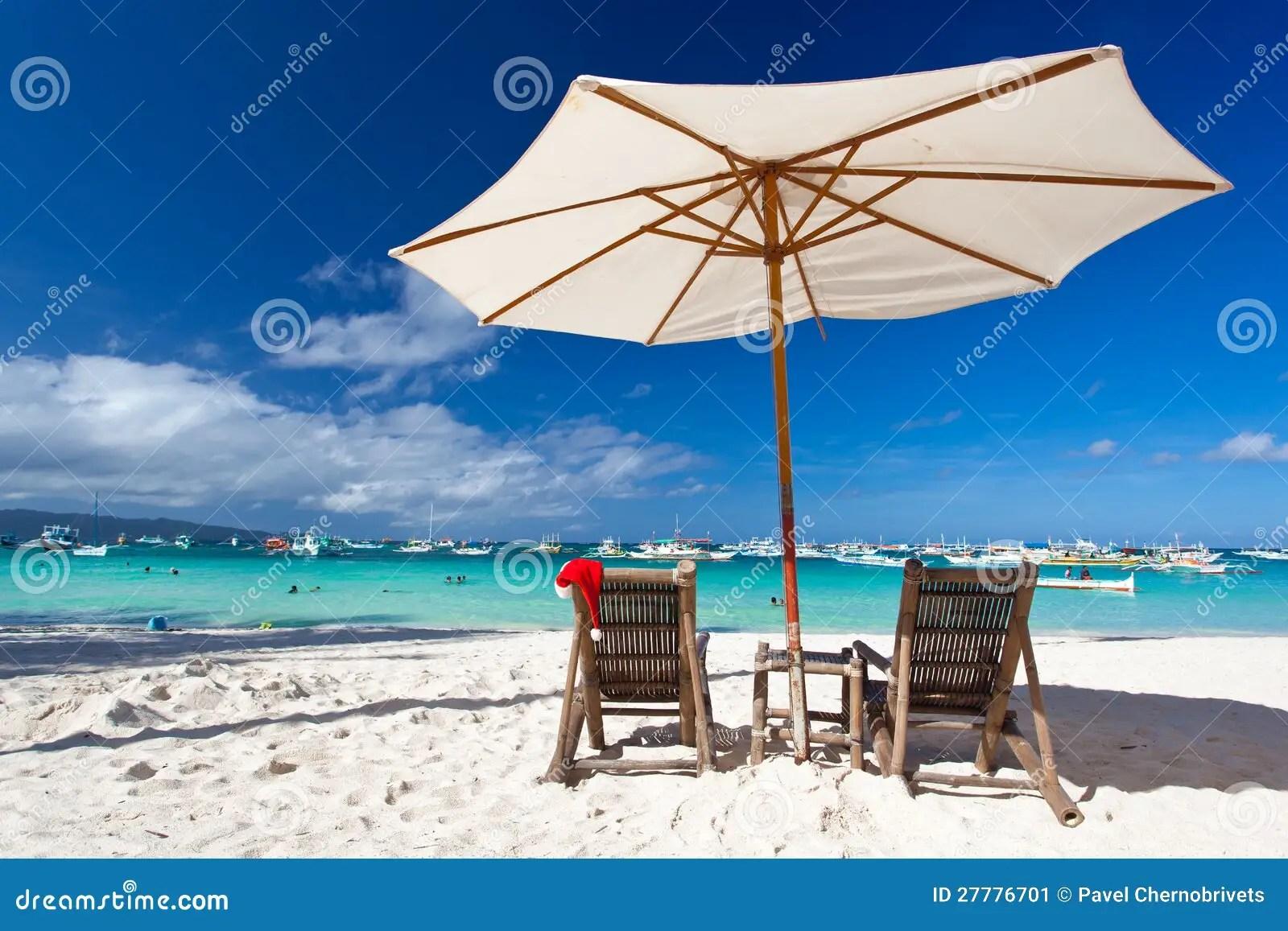 Sun Umbrella With Santa Hat On Chair Stock Image Image