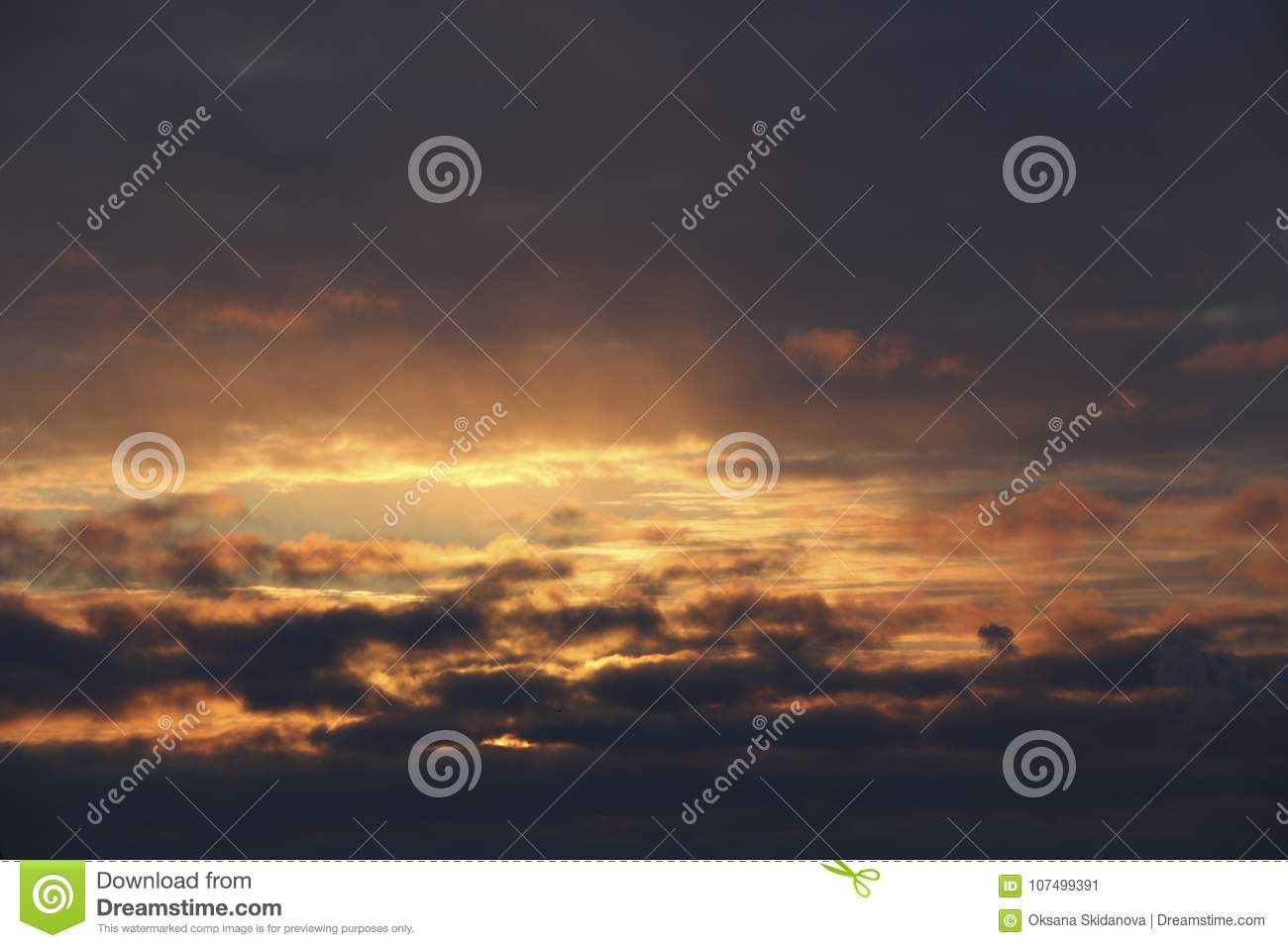 Sunset The Evening Winter Sky In Dense Dark Clouds The