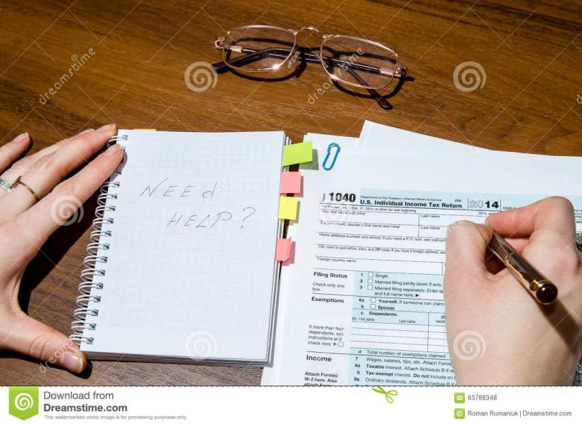 1040 tax form editorial stock photo  Image of accountant   63788348 Woman hand filling income tax forms 1040