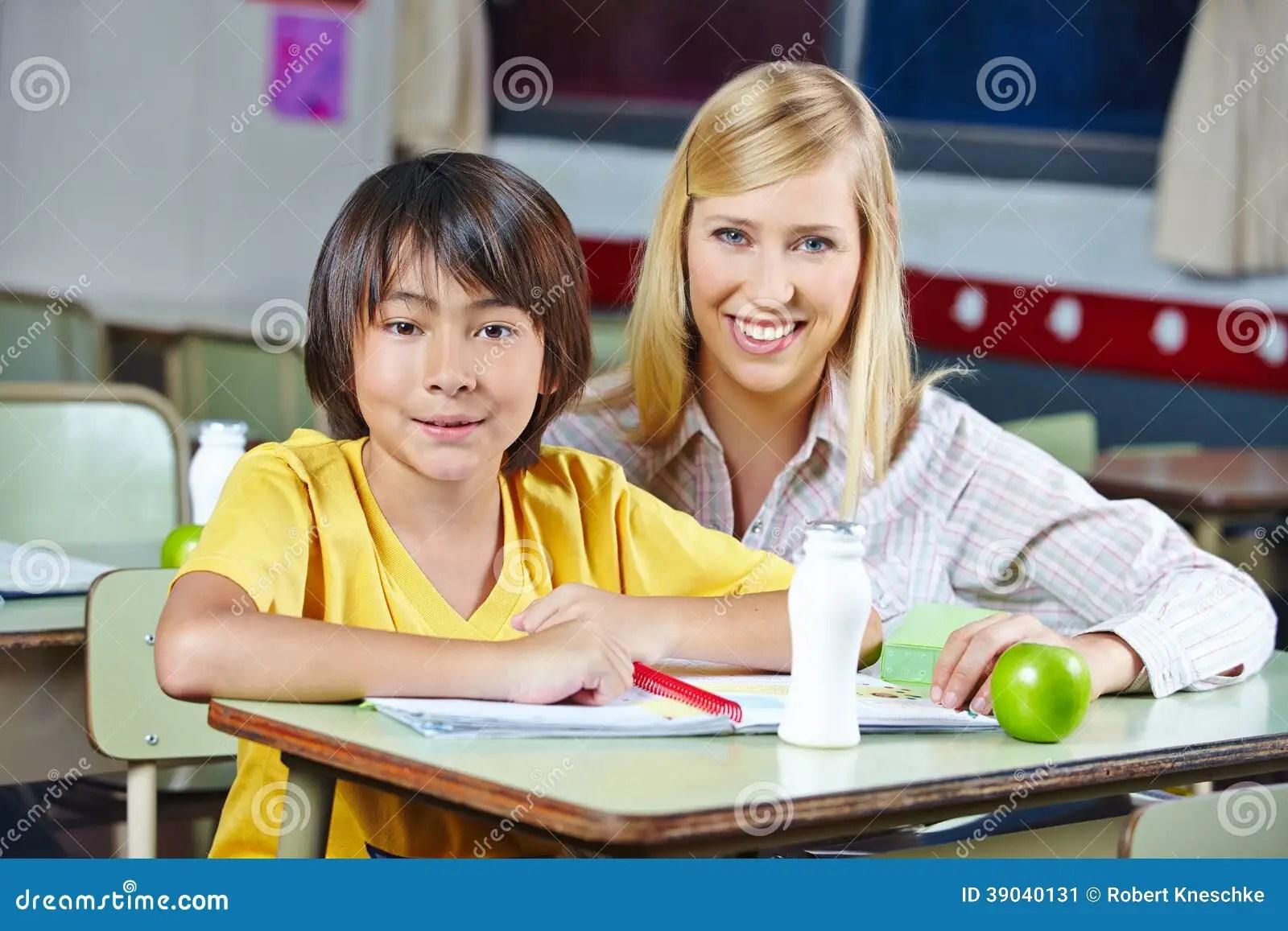 Teacher Coaching Japanese Student Stock Photo