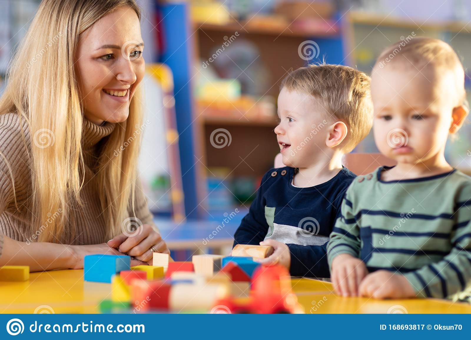 Teacher And Cute Little Girl Play With Blocks Toy In