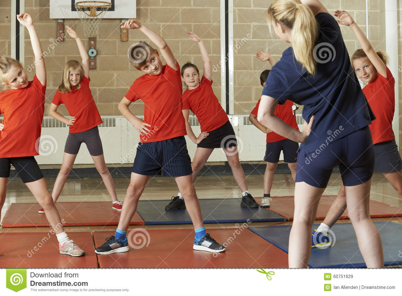 Teacher Taking Exercise Class In School Gym Stock Image