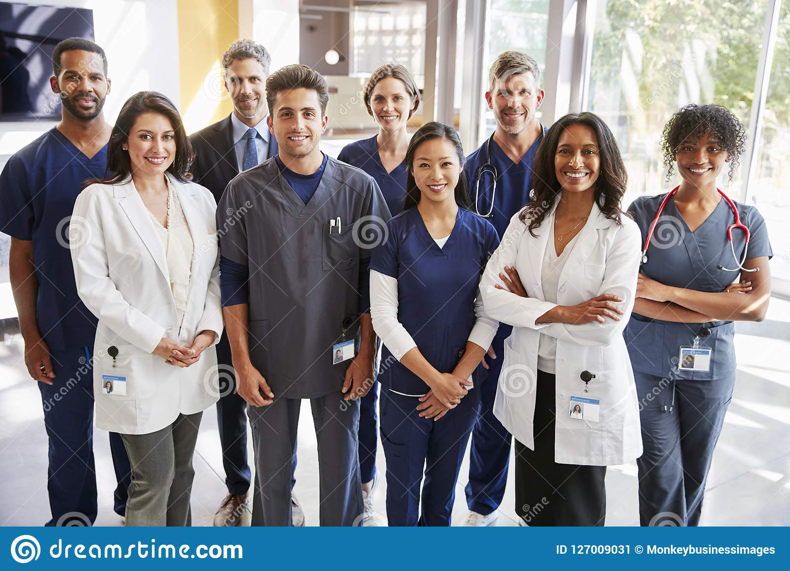Team Of Healthcare Workers At A Hospital Smiling To Camera