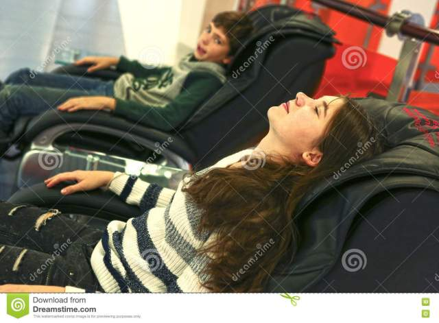 Teen Siblings Brother And Sister In Massage Chair