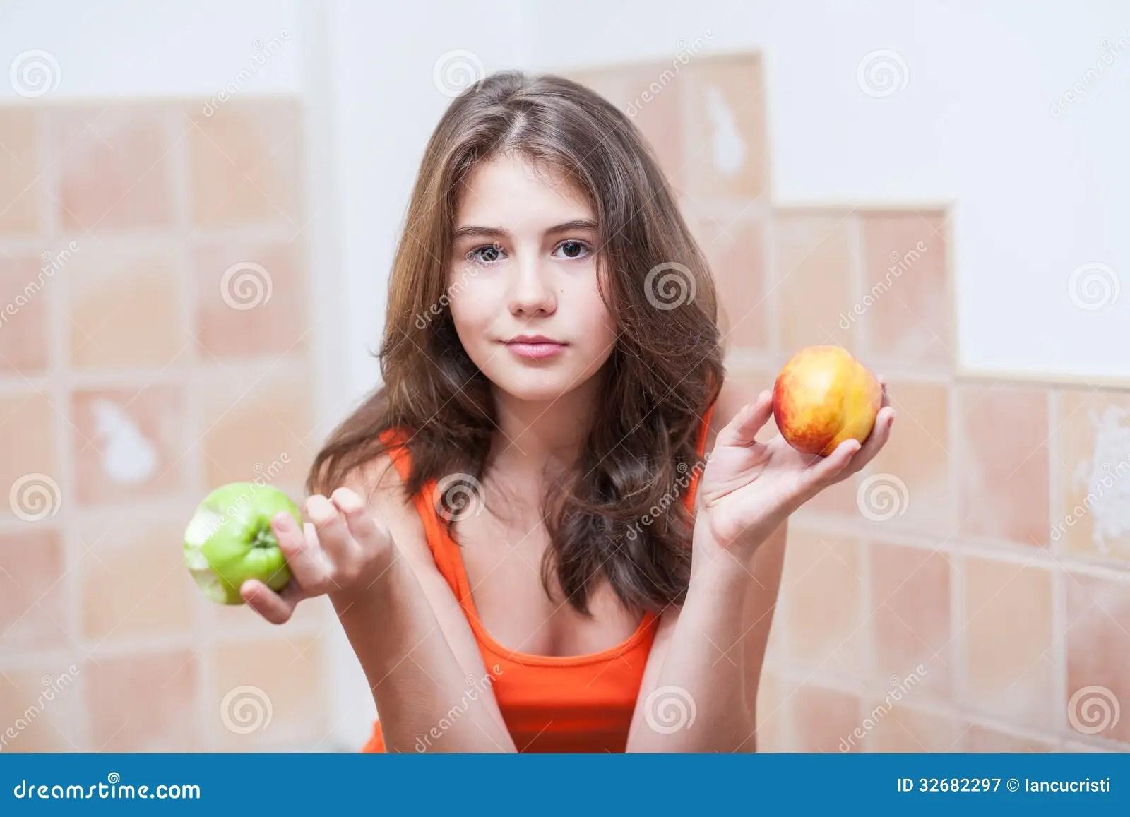 Teenage Girl In Orange T Shirt Looking At Camera Having A