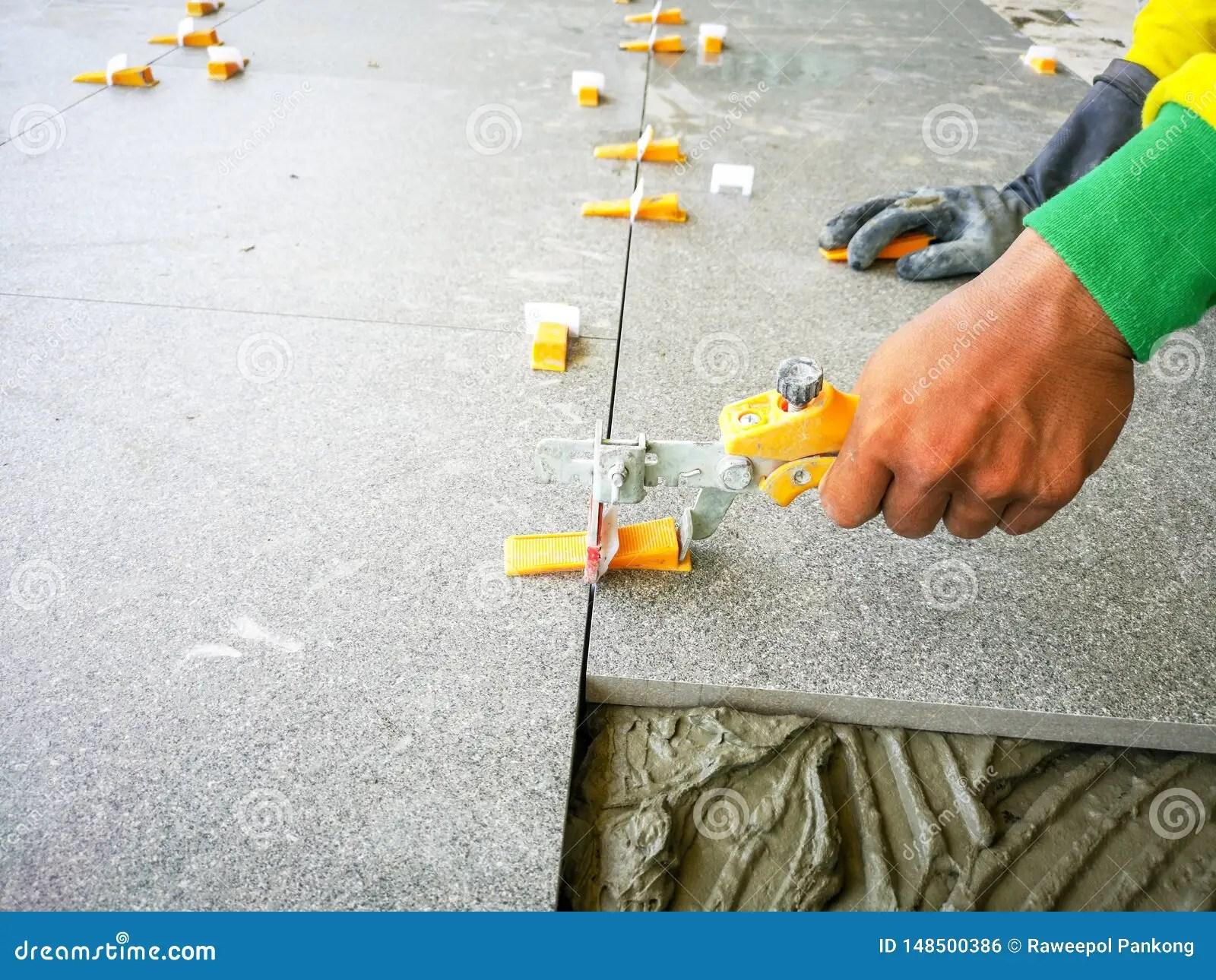 https www dreamstime com tile work placing ceramic floor lash leveling system image148500386