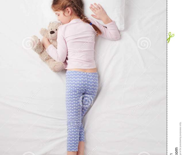 Top View Of Little Cute Girl Sleeping With Teddy