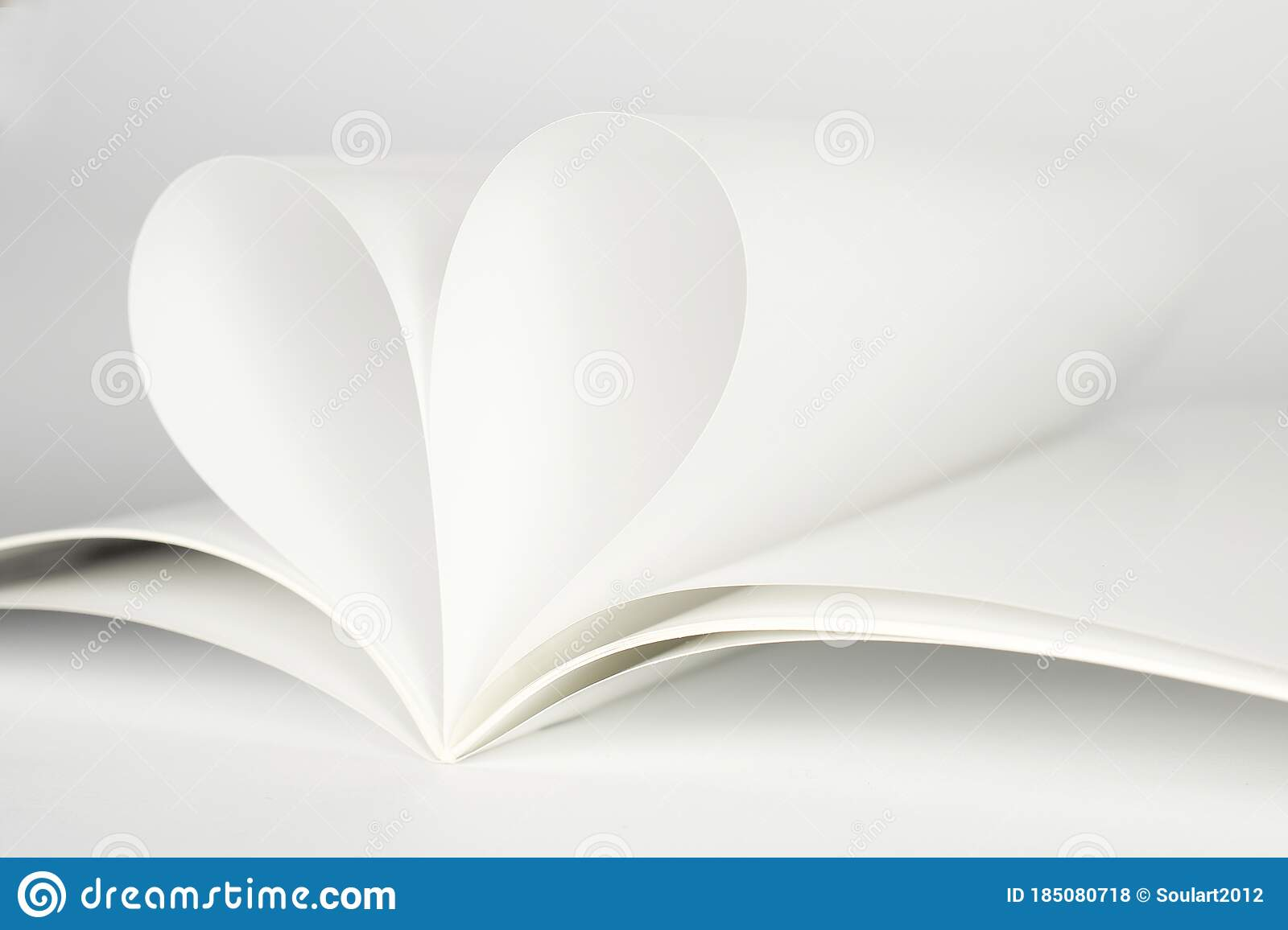 Two Blank Magazine Pages That Becomes One Heart Shape