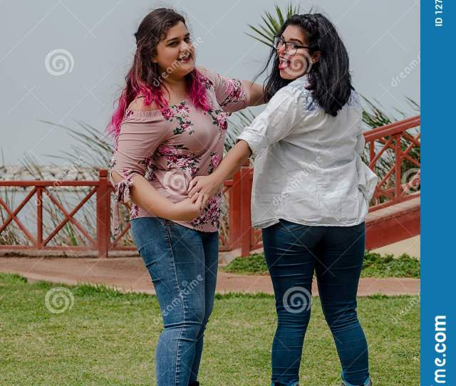 Two Chubby Girls With Inline Skates In The Park