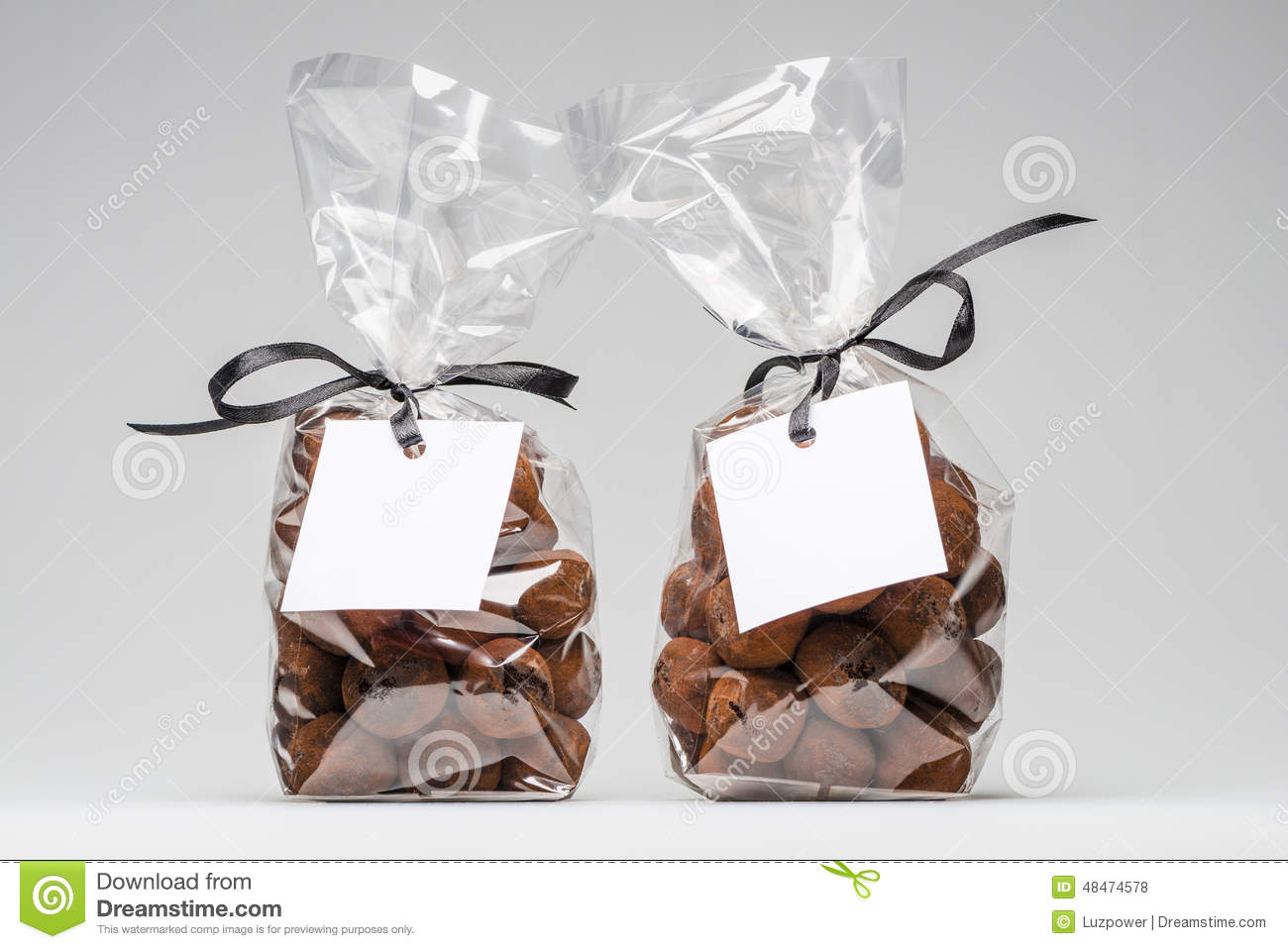 Two Elegant Plastic Bags Of Chocolate Truffles For