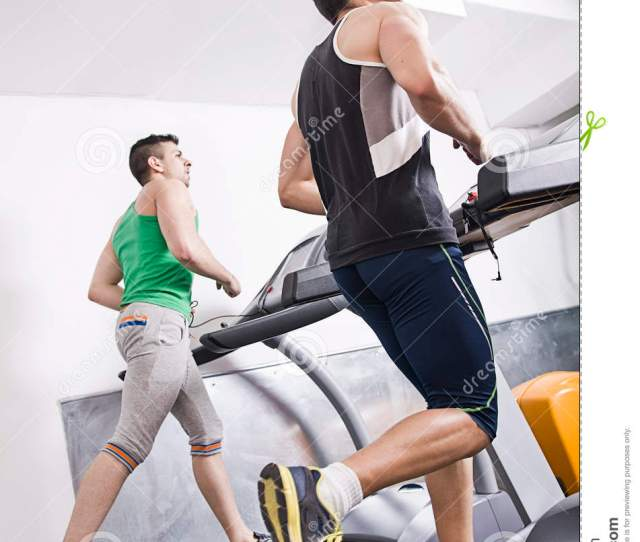 Gym People Running On Treadmill Indoor In Fitness Club
