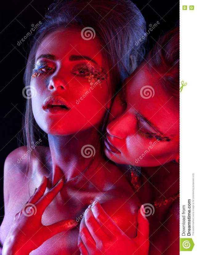 Two Hot Lesbian Woman In Tender Embracing