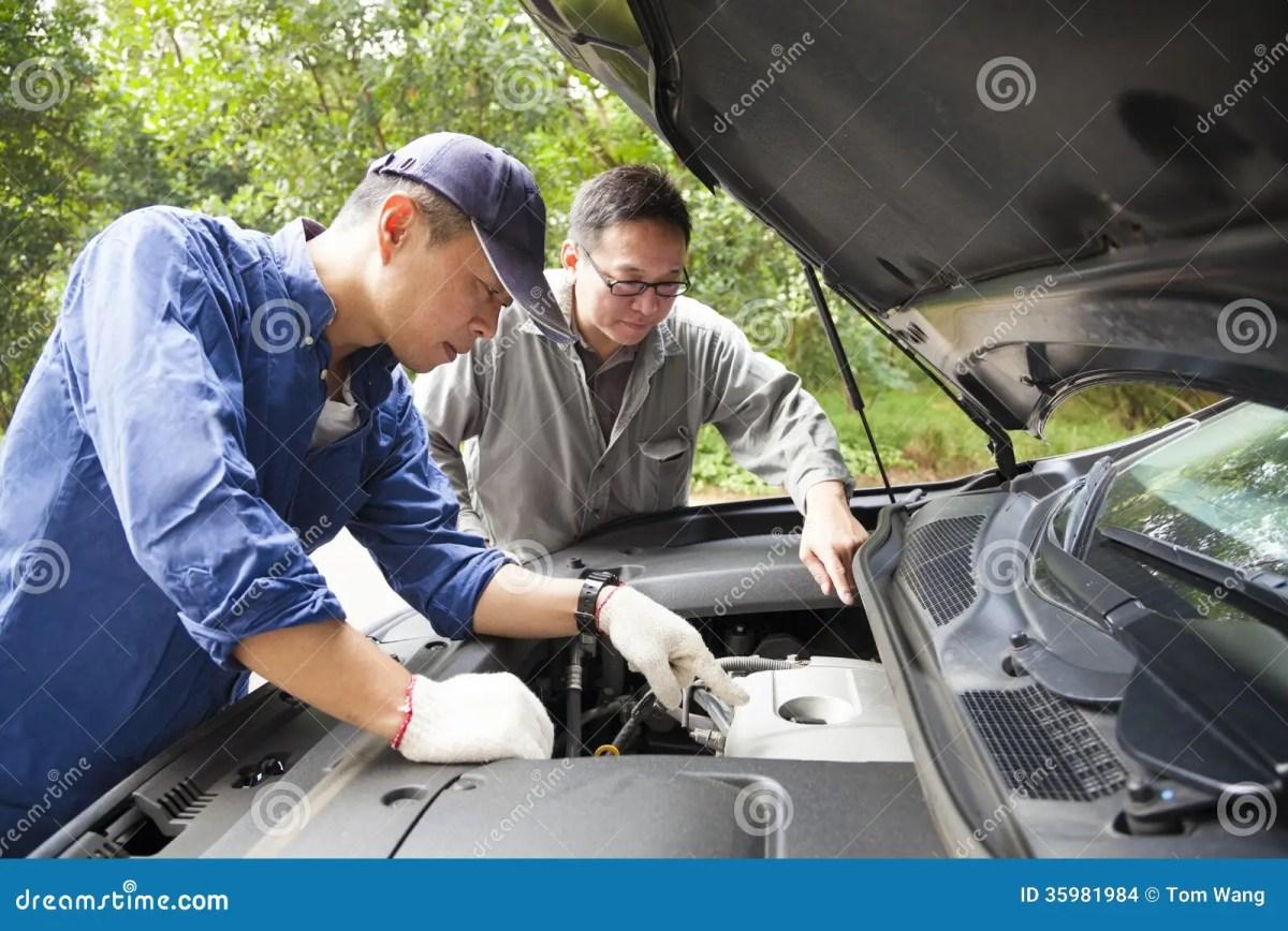 Two Mechanics Fixing The Car Stock Photo Image 35981984
