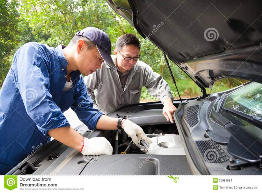 Two Mechanics Fixing The Car Stock Photo Image 35981984
