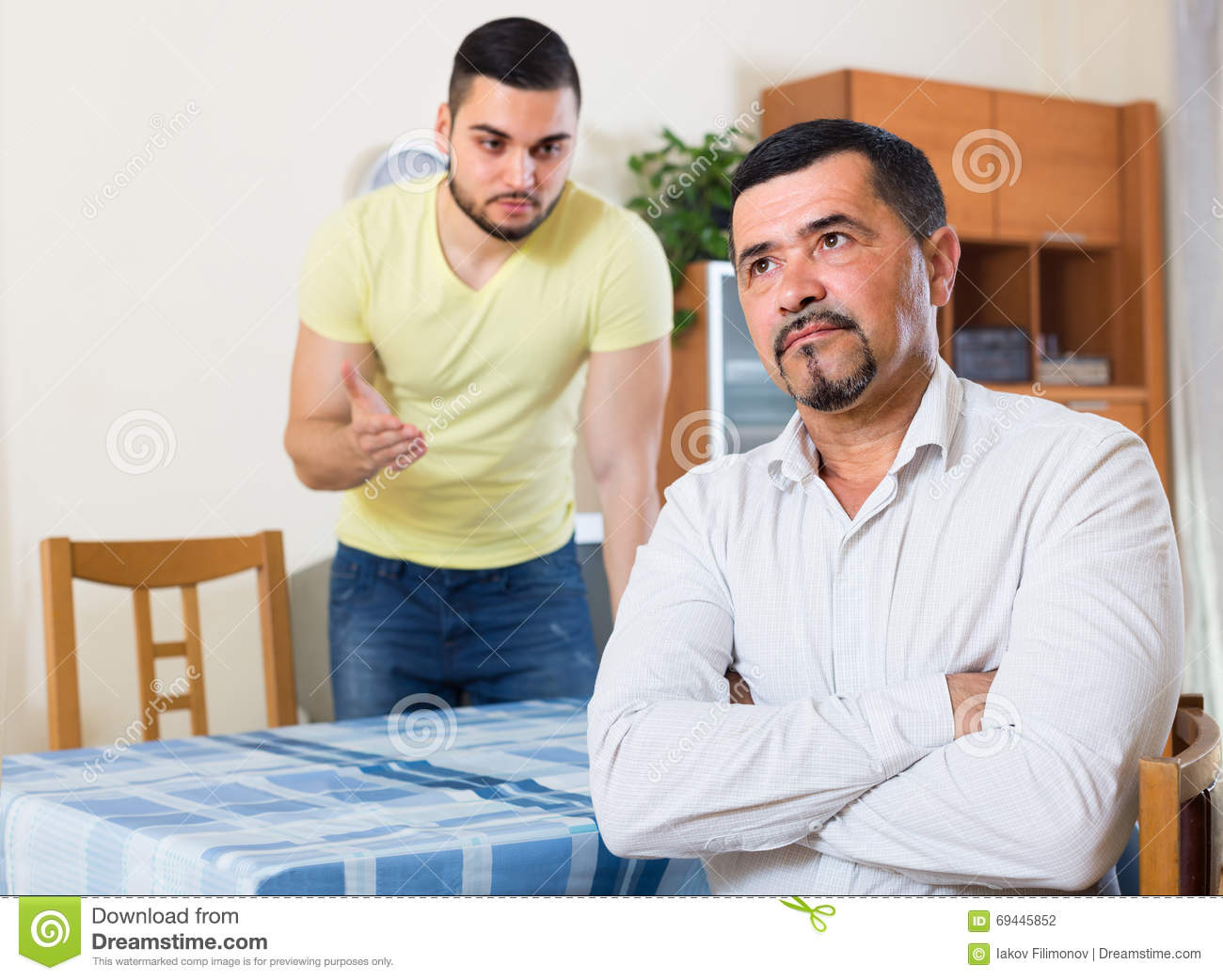 Two Serious Men Having Conflict Stock Photo