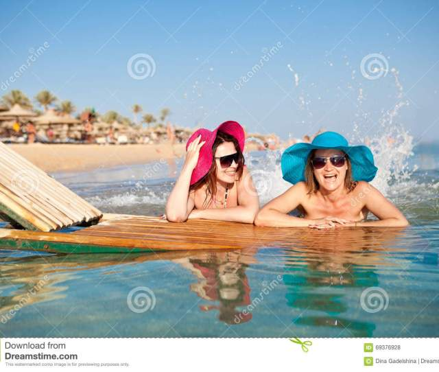 Two Young Women Squirting On The Beach