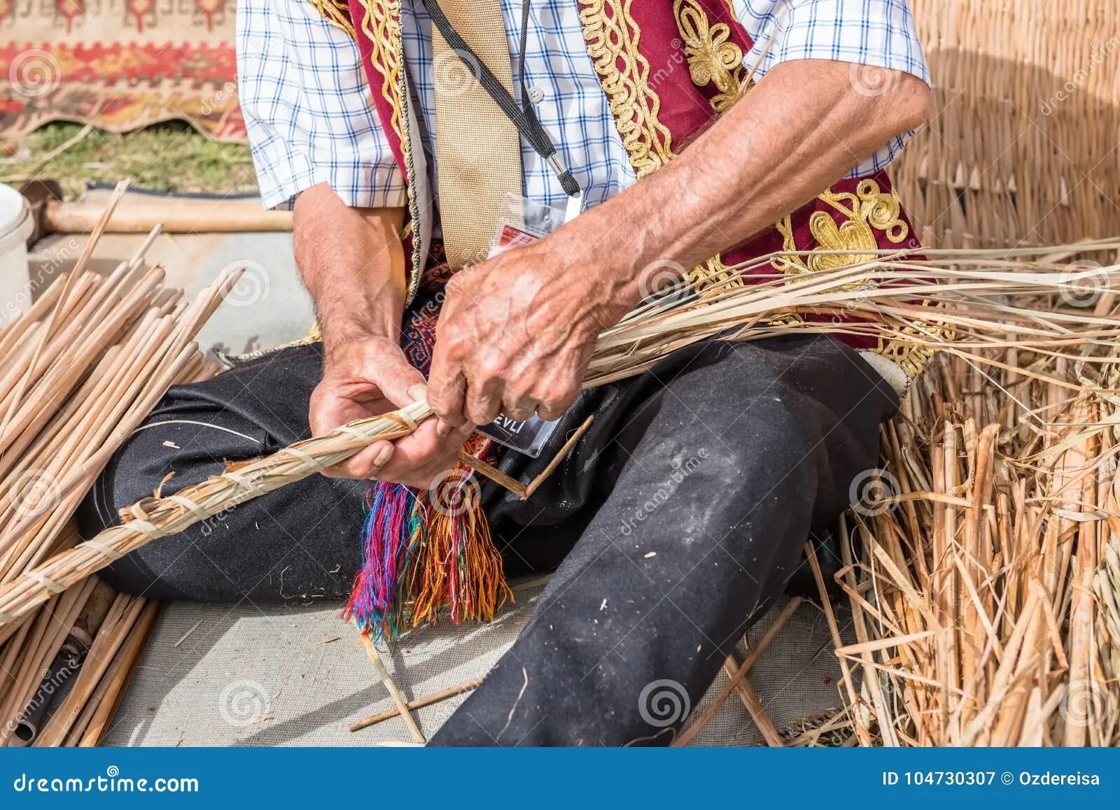 Old Turkish Man Making Traditional Wicker Basket Stock