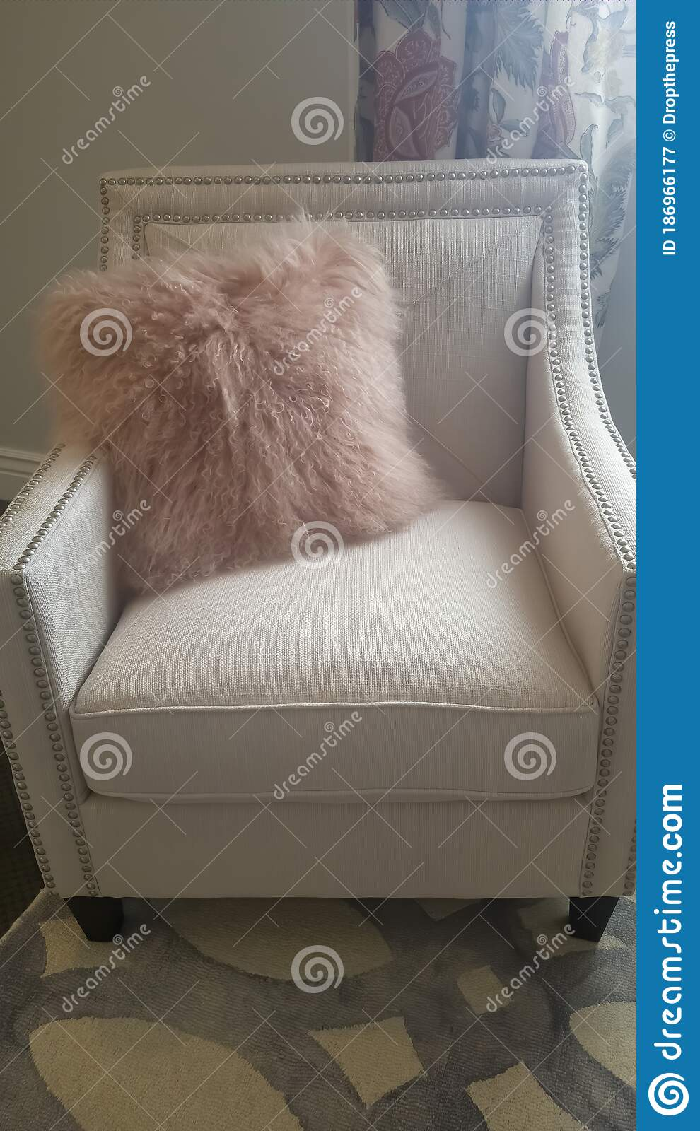 vertical bedroom interior with faux fur throw pillow on a white upholstered armchair stock image image of decorative chair 186966177