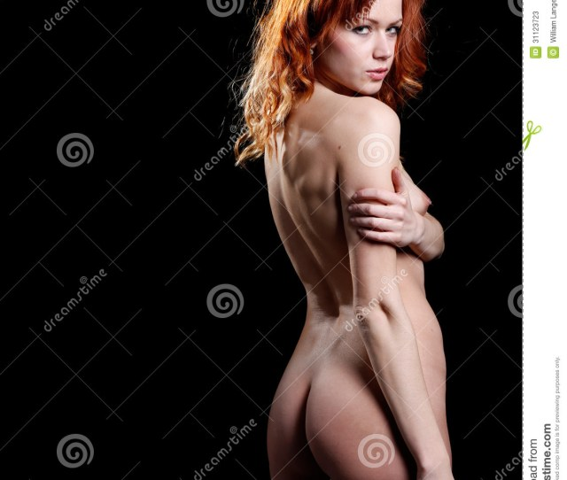 Very And Beautiful Nude Or Naked Woman With Red Hair On A Dark Background