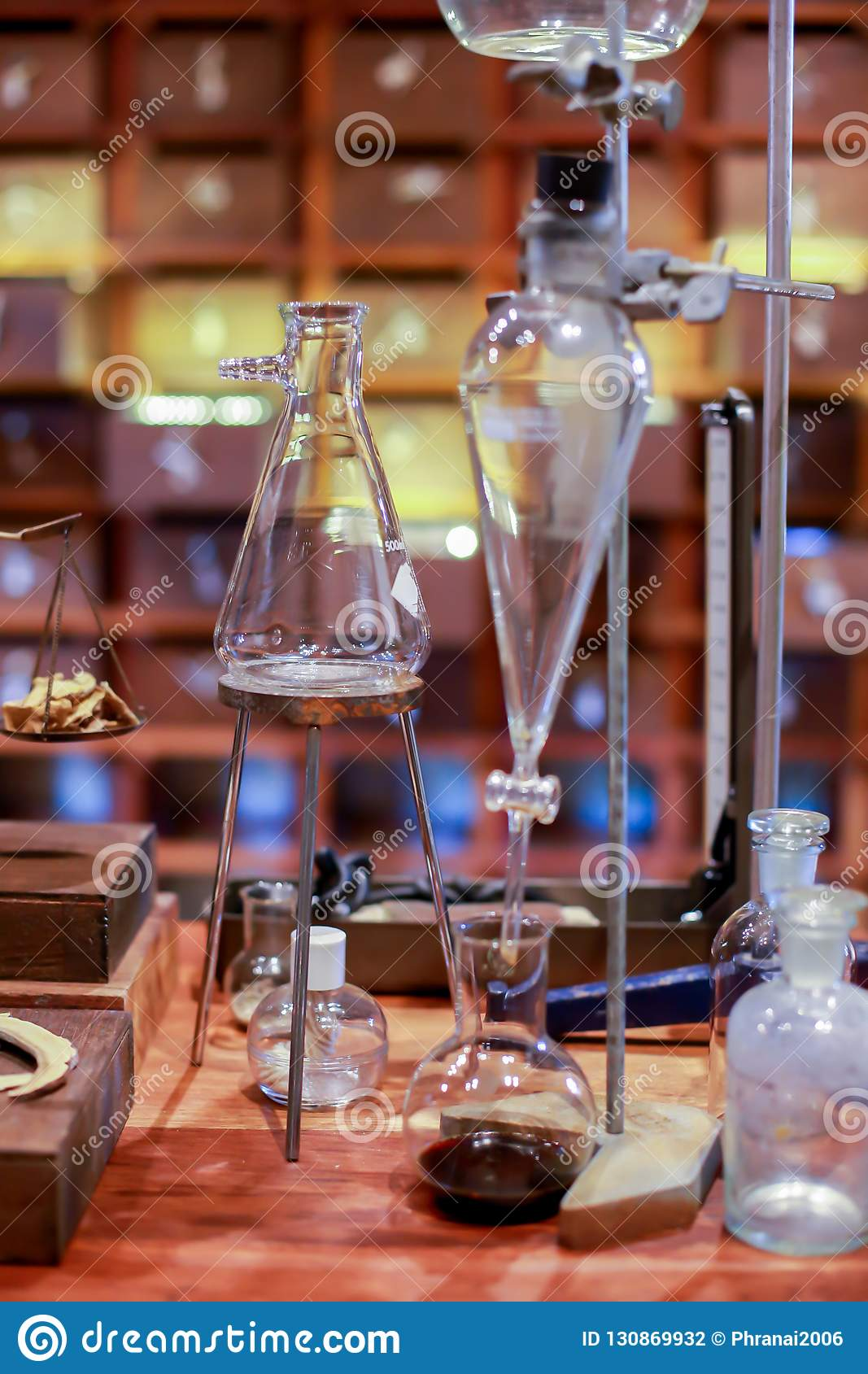 Vintage Equipment Of Chemical Laboratory On Wooden Table