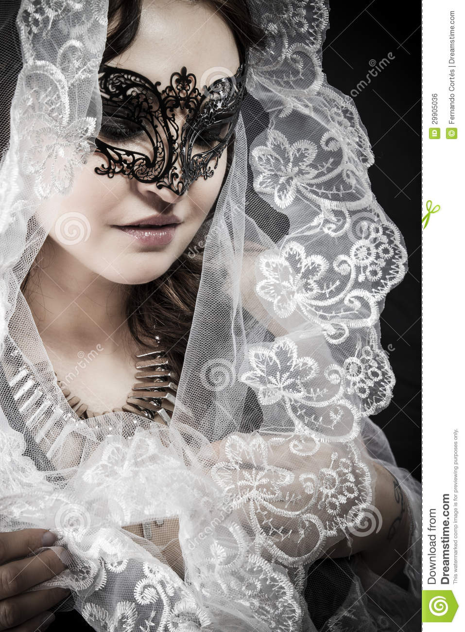 Virgin Woman In Veil And Black Dress With Venetian Mask