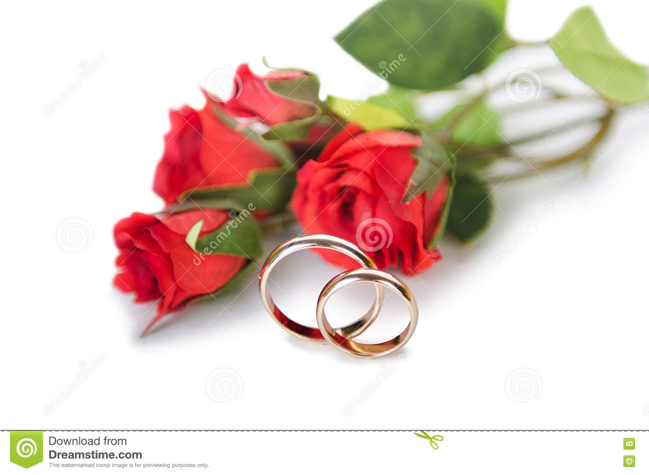 The Wedding Rings And Flowers Isolated On White Background