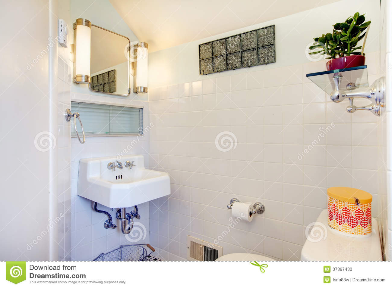 White Bathroom Decorated With Flower Pot And Rustic Hanger