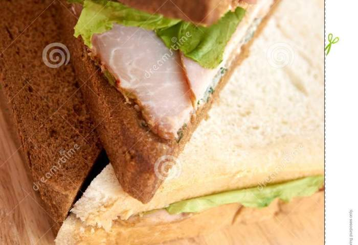 White And Black Bread Sandwich With Ham Light Background Stock
