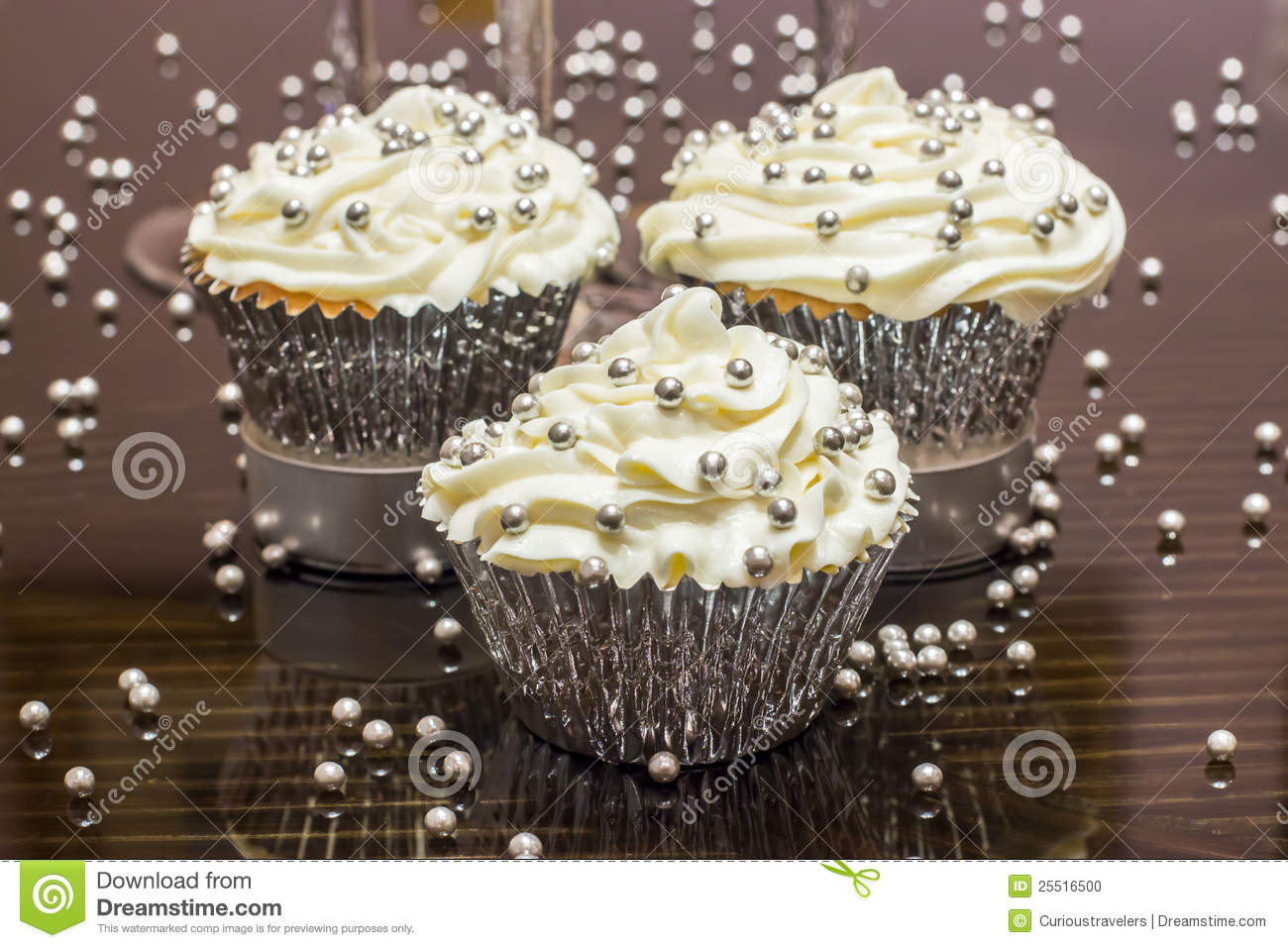 White Cupcakes With Silver Decorative Sprinkles Stock