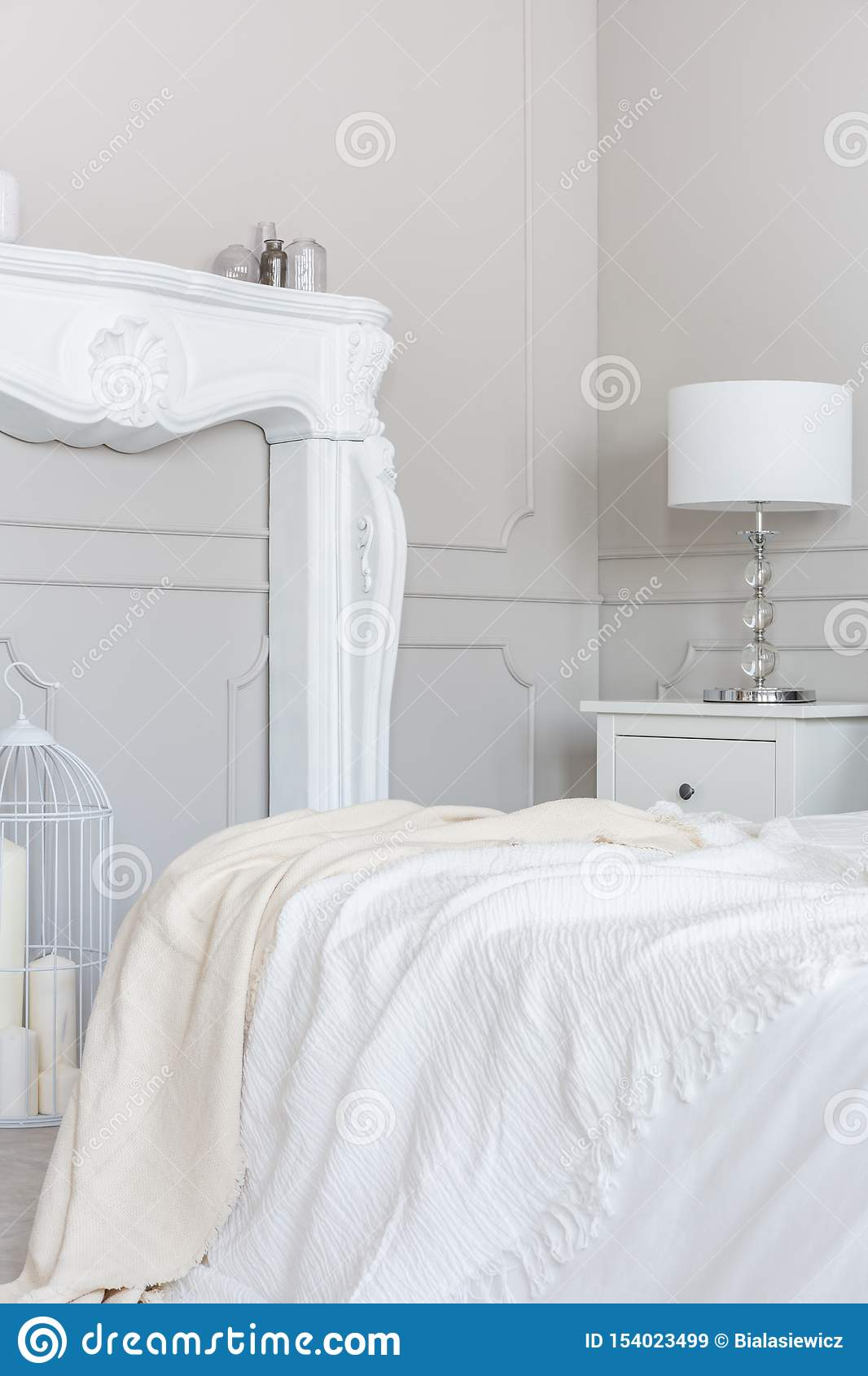 White Wooden Fireplace Portal In Beautiful Bedroom Interior With White Sheets On King Size Bed Stock Image Image Of Floor Decor 154023499