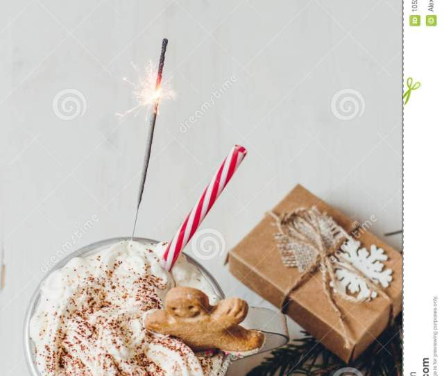 Download Winter Hot Drink With Gingerbread Men Cookie Sparkler And Christmas Decoration On The Wooden