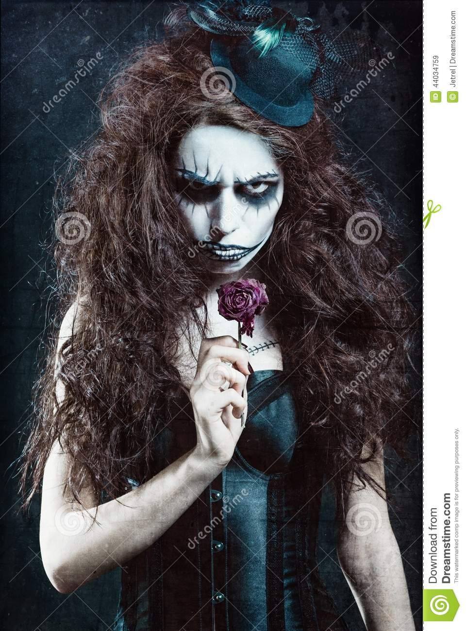 Woman In Image Of Gothic Freak Clown With Withered Flower