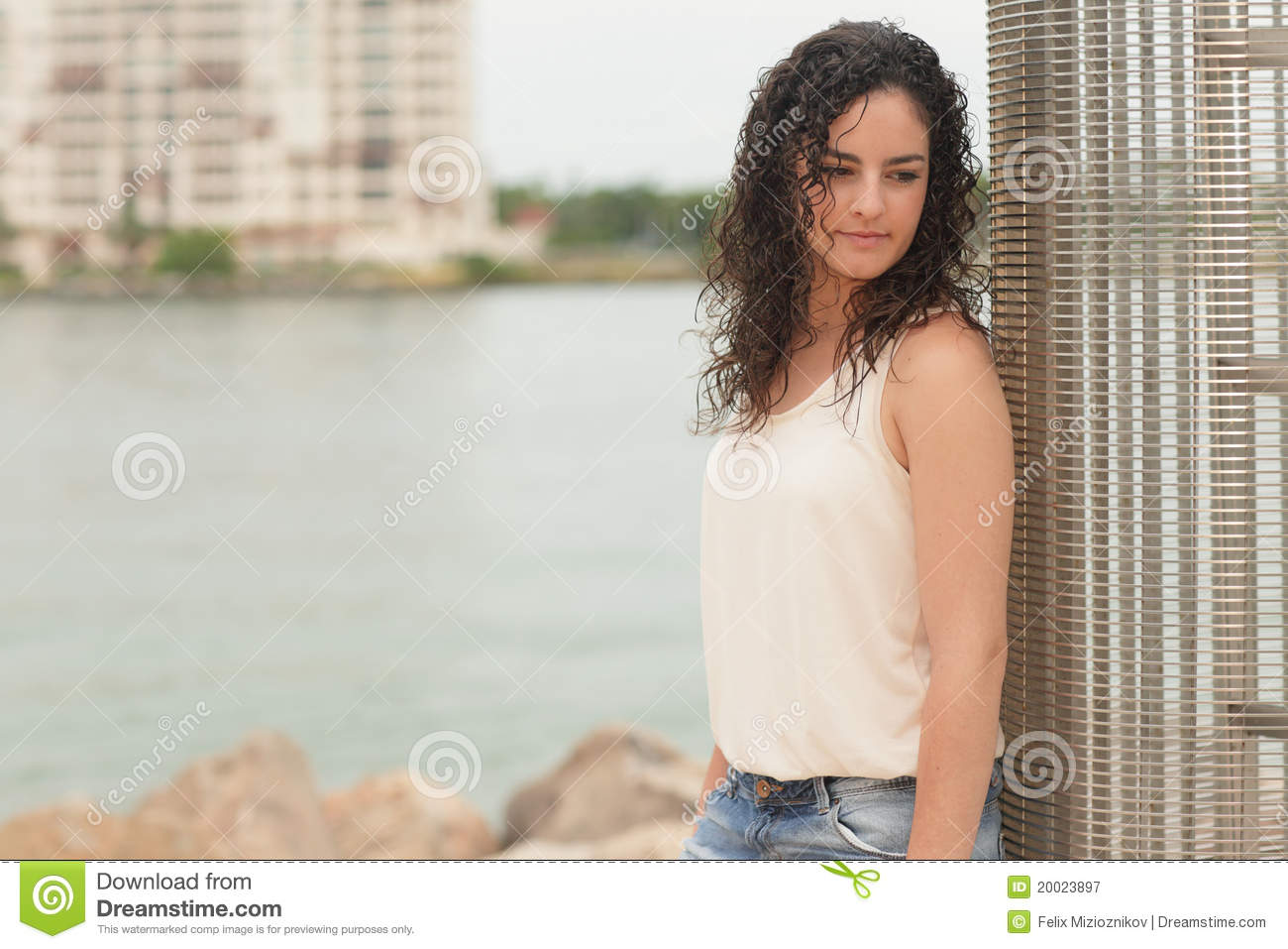 Woman Looking Over Her Shoulder Royalty Free Stock