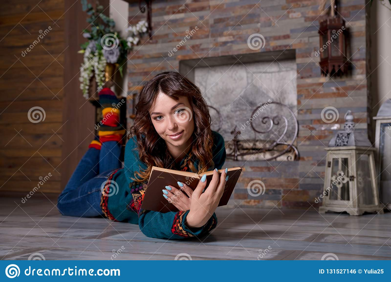 Woman Reading A Book And Enjoying A Hot Chocolate By The