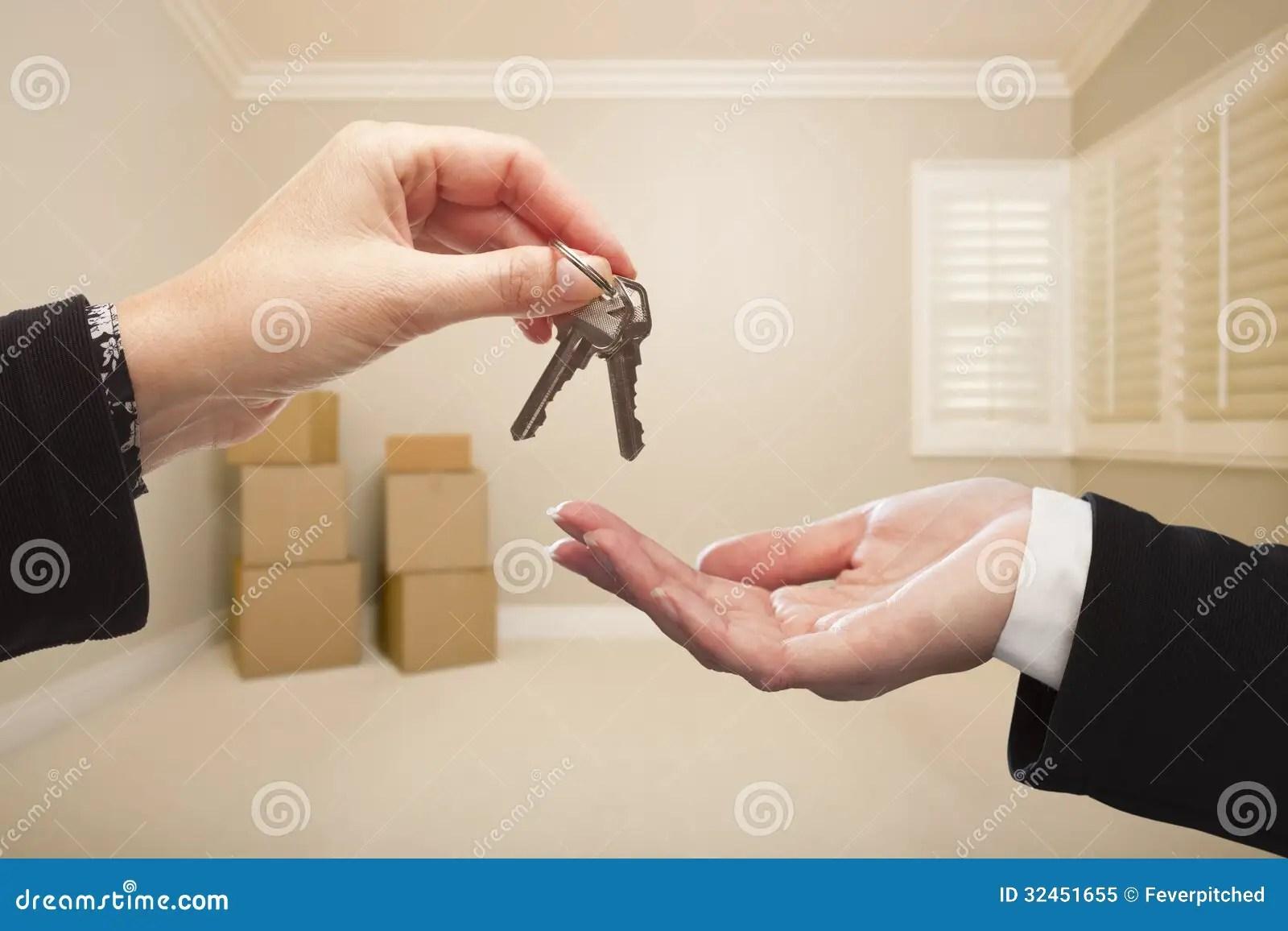 Womans Hands Handing Over The House Keys Inside Empty Tan