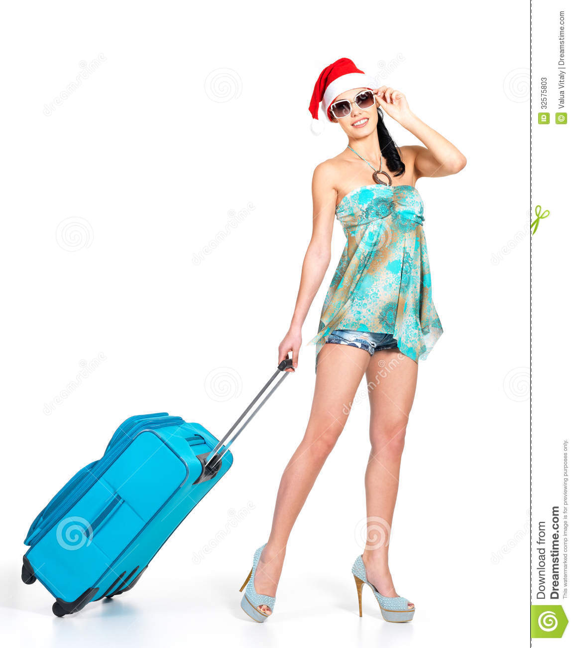 Woman In Santa Hat Standing With Travel Suitcase Stock