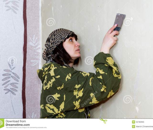 Woman Scraped The Old Wallpaper