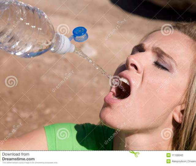 Woman Squirting Water From Bottle