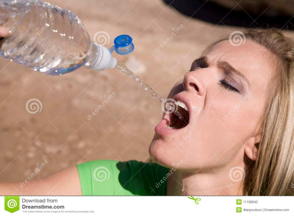 Woman Squirting Water From Bottle Stock Photography Image